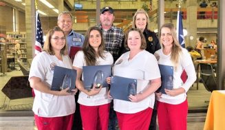 SIX HONORED WITH COM'S DISTINGUISHED SERVICE AWARD